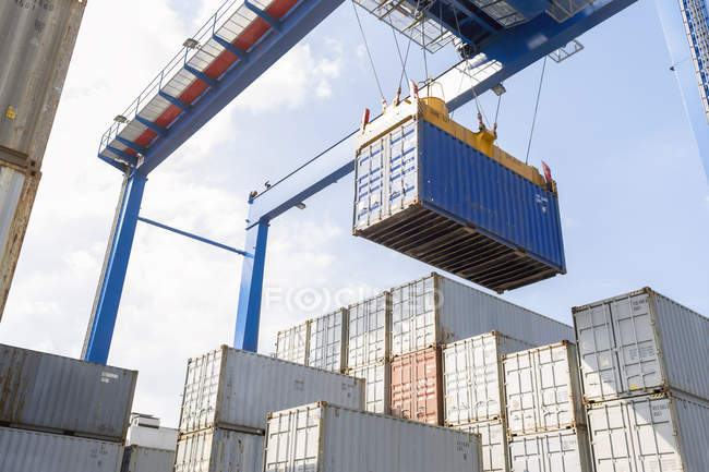 Crane lifting container at harbor — Stock Photo