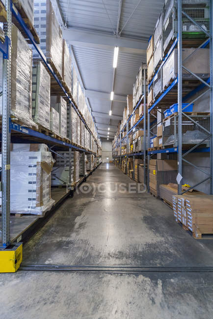 High rack warehouse with packed products — Stock Photo