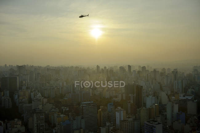 Brazil, Sao Paulo, cityview and helicopter in the evening — Stock Photo