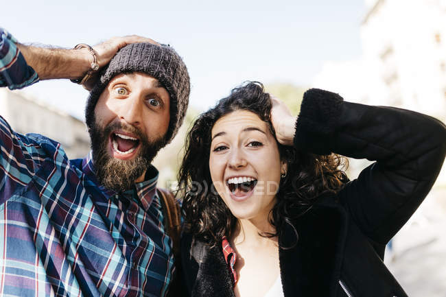 Couple pulling faces — Stock Photo