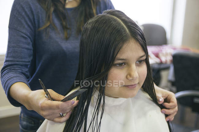 Close up view of Girl in a hair salon — Stock Photo