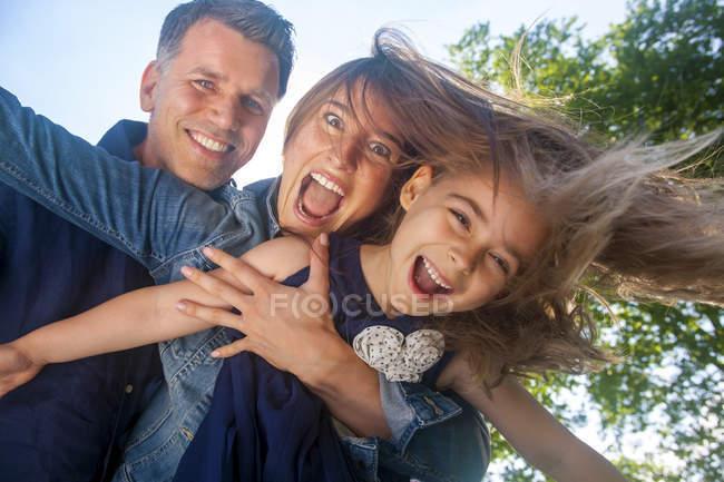 Happy family having fun, pretending to fly — Stock Photo