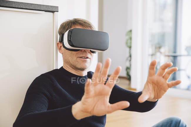 Man wearing virtual reality glasses using his hands — Stock Photo