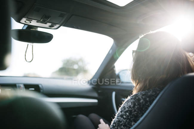 Female front passenger sitting in car — Stock Photo