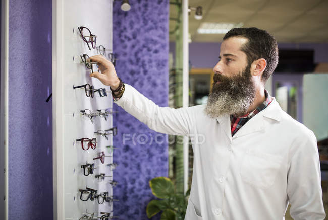 Optometrist checking glasses — Stock Photo