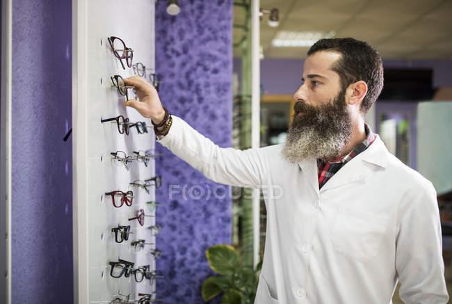 Optometrist checking glasses — Stock Photo