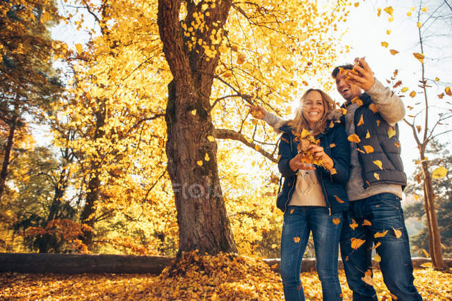 Couple having fun in forest — Stock Photo