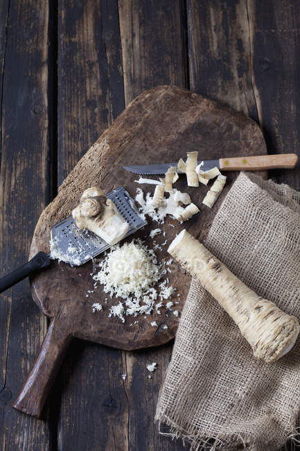 Partly grated horseradish — Stock Photo