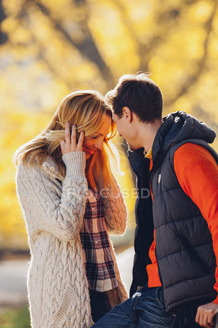 Couple standing face to face in forest — Stock Photo