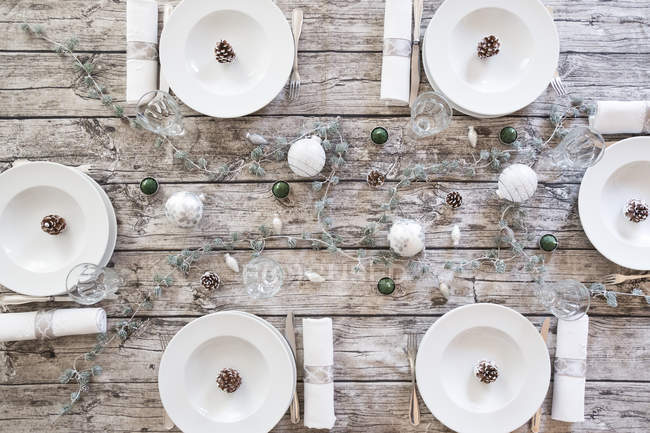 Laid table settings with Christmas decoration — Stock Photo