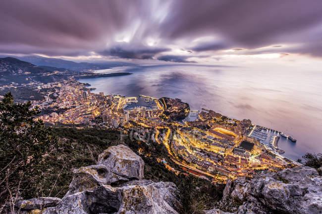 Monaco, View of Monte Carlo, dramatic evening sky and illuminated cityscape — Stock Photo