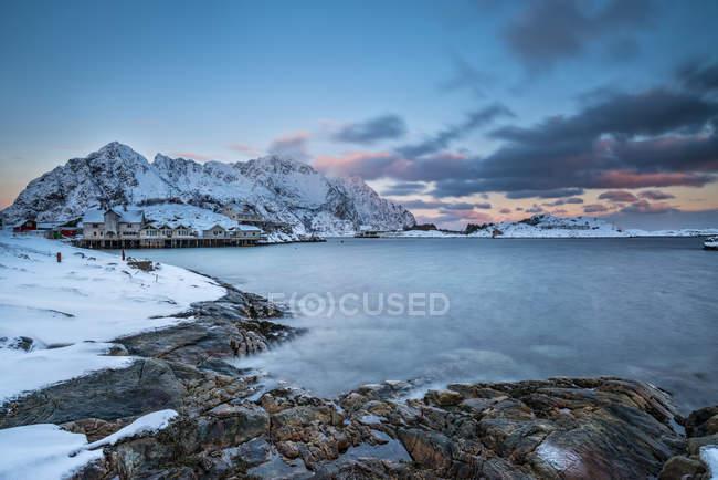 Norway, Lofoten Islands, Henningsvajer town at sunset in winter — Stock Photo