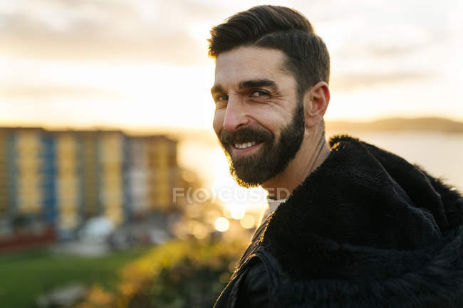 Portrait of bearded man at evening twilight — Stock Photo