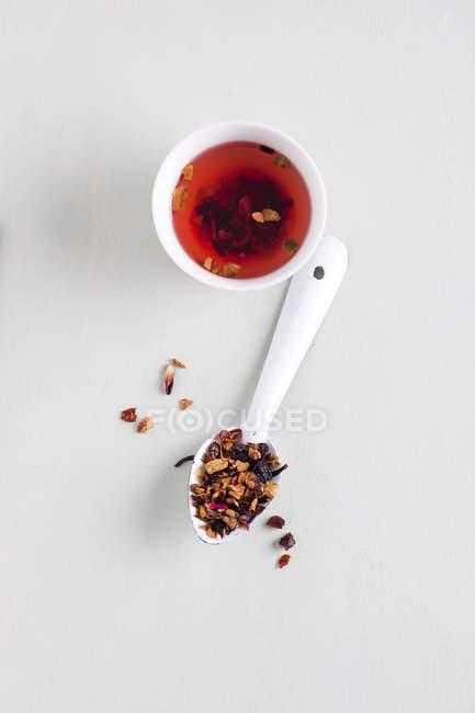 Fruit Tea in cup, spoon, wintertea, top view — Stock Photo