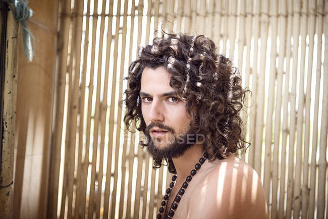 Man with beard and curly hair — Stock Photo