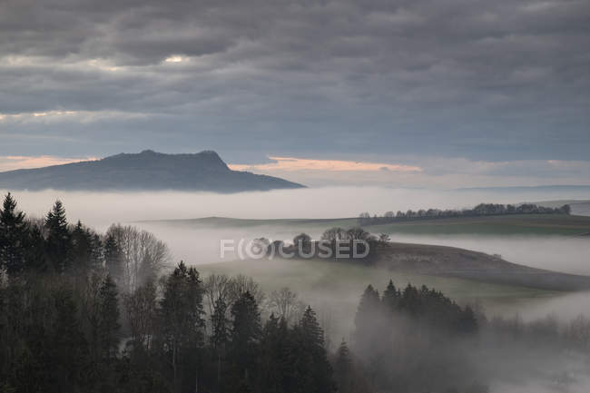 Germany, Baden-Wuerttemberg, Constance district, Hegau, volcanic landscape and fog — Stock Photo