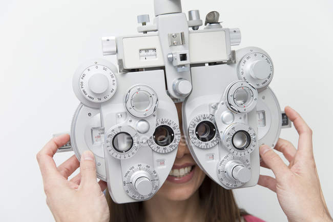 Woman at the optometrist making an eye test — Stock Photo