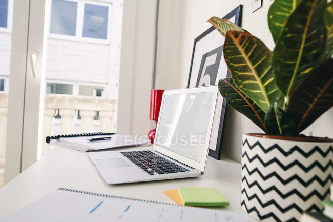Empty workplace with laptop at home office — Stock Photo