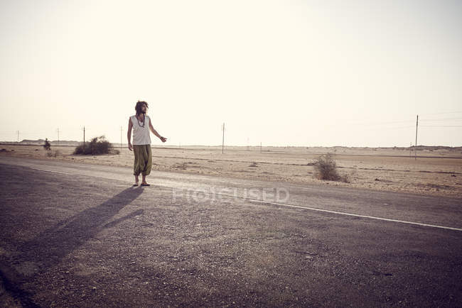 Man travelling alone on country road — Stock Photo