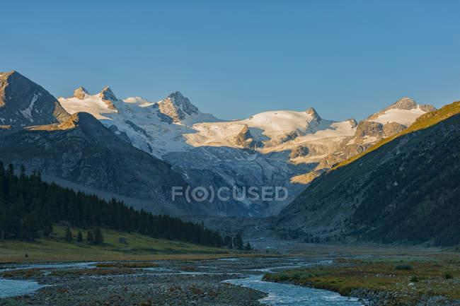 View of Bernina glacier and river at sunrise, Roseg valley, Switzerland — Stock Photo