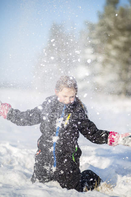 Girl throwing snow in the air — Stock Photo