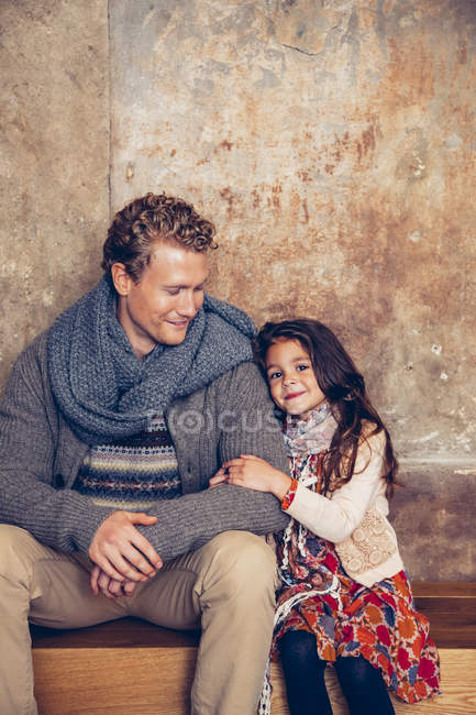 Peachy Smiling Father And Daughter Sitting On Wooden Bench Two Bralicious Painted Fabric Chair Ideas Braliciousco