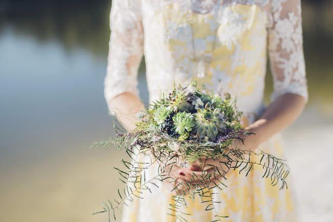 Close-up of bride holding elegant bridal bouquet — Stock Photo