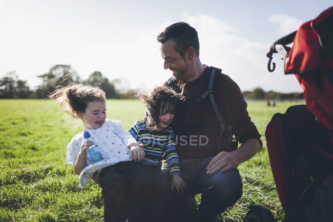 Father and his children having fun in the nature — Stock Photo