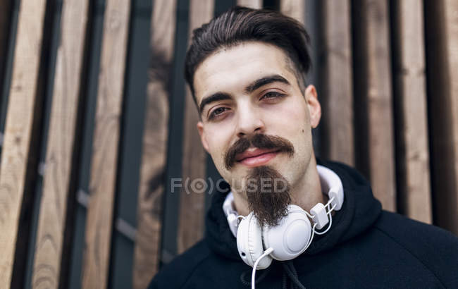 Portrait of stylish young man with headphones — Stock Photo