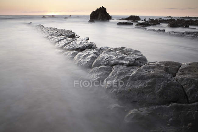 Spain, Basque Country, Pais Vasco, Barrika beach at sunset — Stock Photo