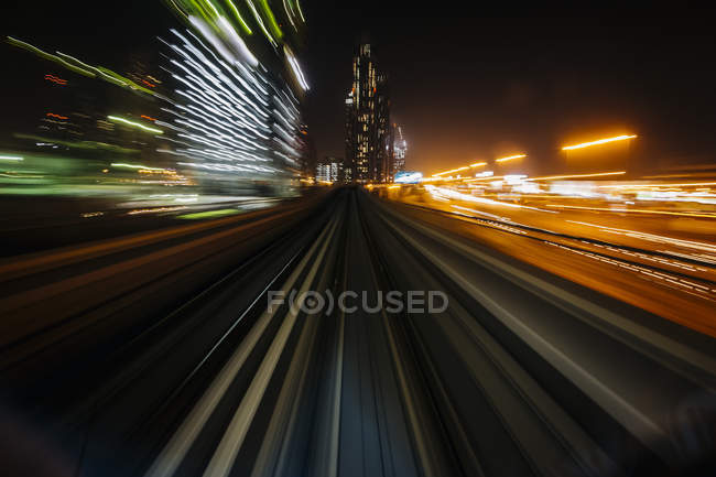 UAE, Dubai, railway at night, blurred motion — Stock Photo