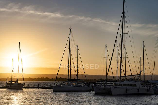 Boats at marina at sunset, Siracuse, Sicily, Italy — Stock Photo