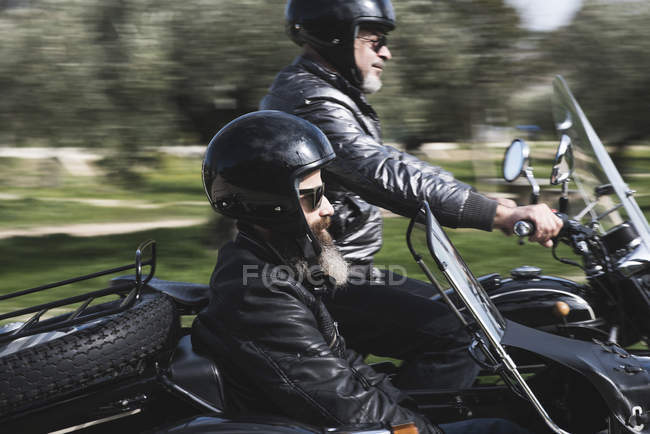 Two bikers driving with sidecar motorcycle — Stock Photo