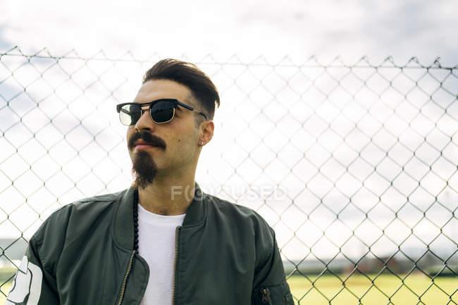 Portrait of a stylish young man wearing sunglasses — Stock Photo