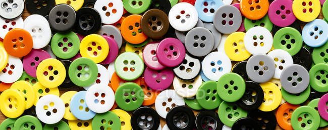 Collection of colourful plastic buttons — Stock Photo