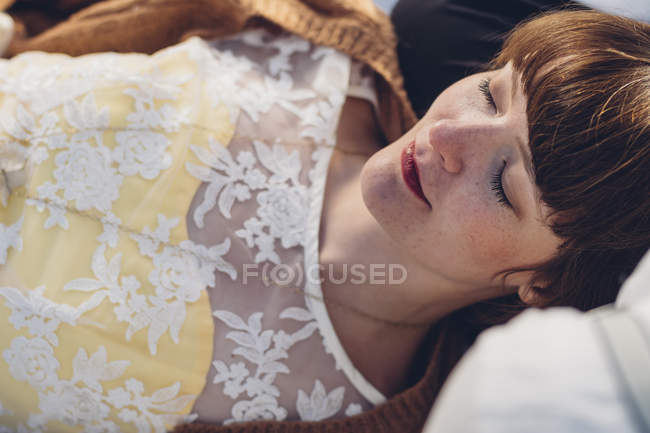 Portrait of woman with closed eyes wearing lace top — Stock Photo