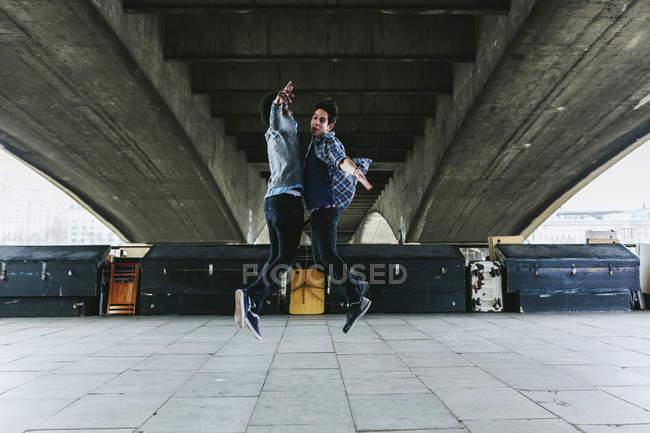 Men jumping in air — Stock Photo
