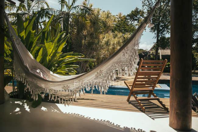 Brazil, Porto Seguro, porch of Bali style apartment hotel with hammock and swimming pool — Stock Photo