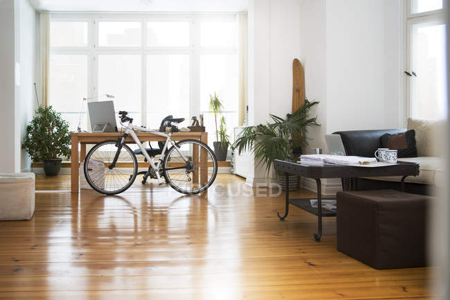 Interior of a modern informal office with bicycle — Stock Photo