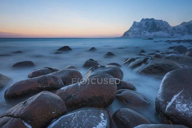 Norway, Lofoten Islands, Utakleiv beach at sunrise in winter — Stock Photo