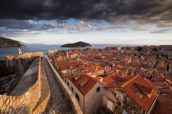Croatia, Dalmatia, Dubrovnik, Old Town, view from city wall at sunset with moody sky — Stock Photo