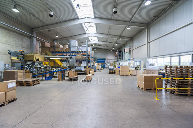 Empty industrial hall with stored packages — Stock Photo