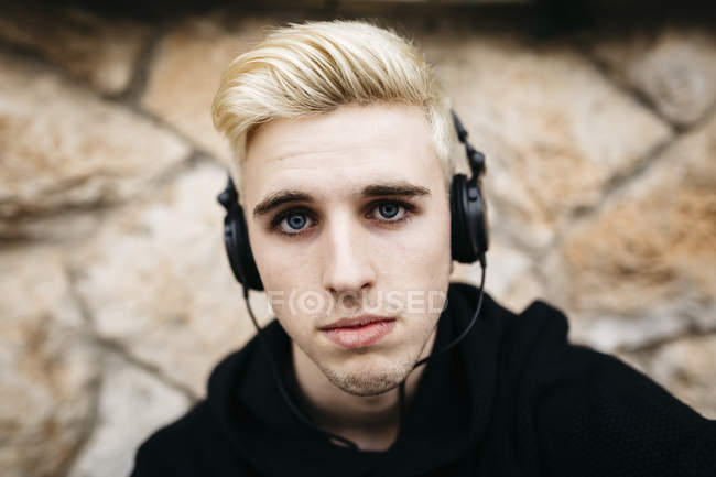 Blond young man with headphones — Stock Photo