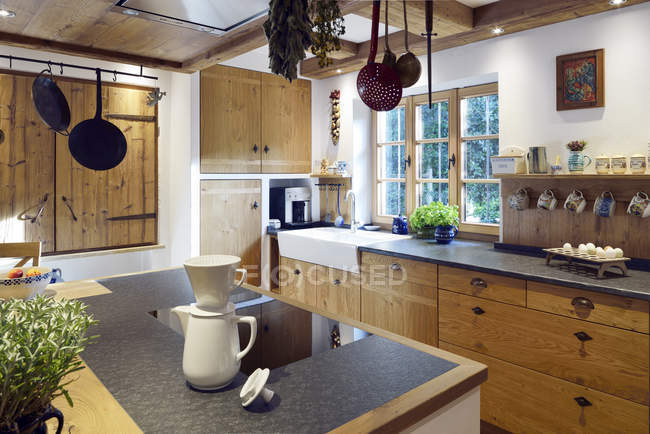 Rustic country style home with kitchen island indoors — Stock Photo