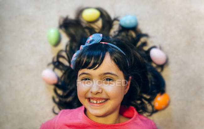 Portrait of happy little girl with Easter eggs — Stock Photo