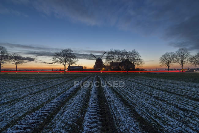 Germany, Gifhorn, Meine, wind mill in winter, field with snow — Stock Photo