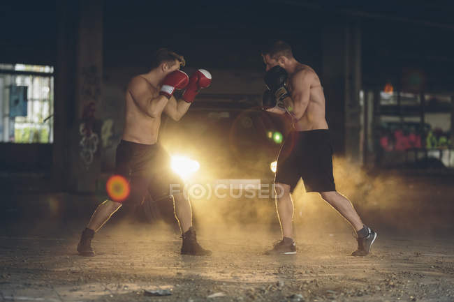 Two boxers fighting in an abandoned factory — Stock Photo