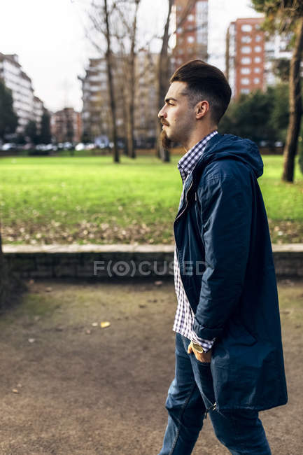 Spain, Gijon, young man walking in the park — Stock Photo