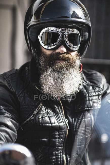 Biker wearing helmet and goggles — Stock Photo