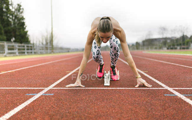 Athlete woman on a running track — Stock Photo